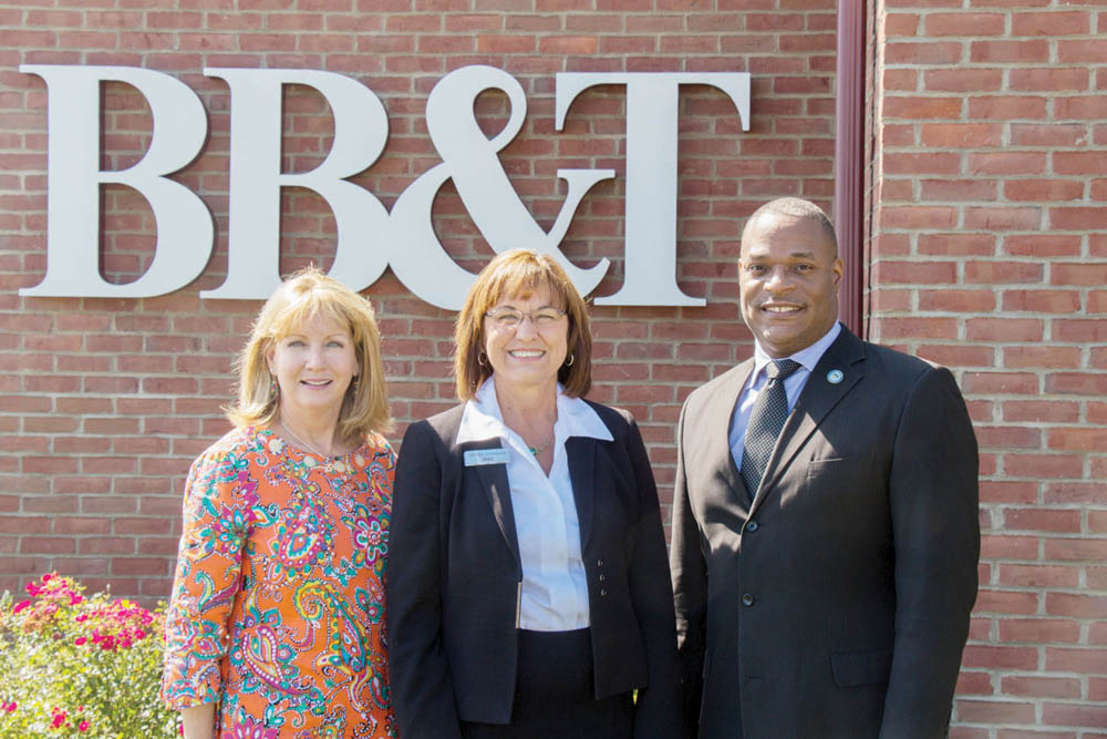 New River Community and Technical College Board of Governors Vice Chair Leslie Baker (left) and President L. Marshall Washington pictured with Debby Sizemore, BB&T market president, following the presentation of a check to the New River Community and Technical College Foundation