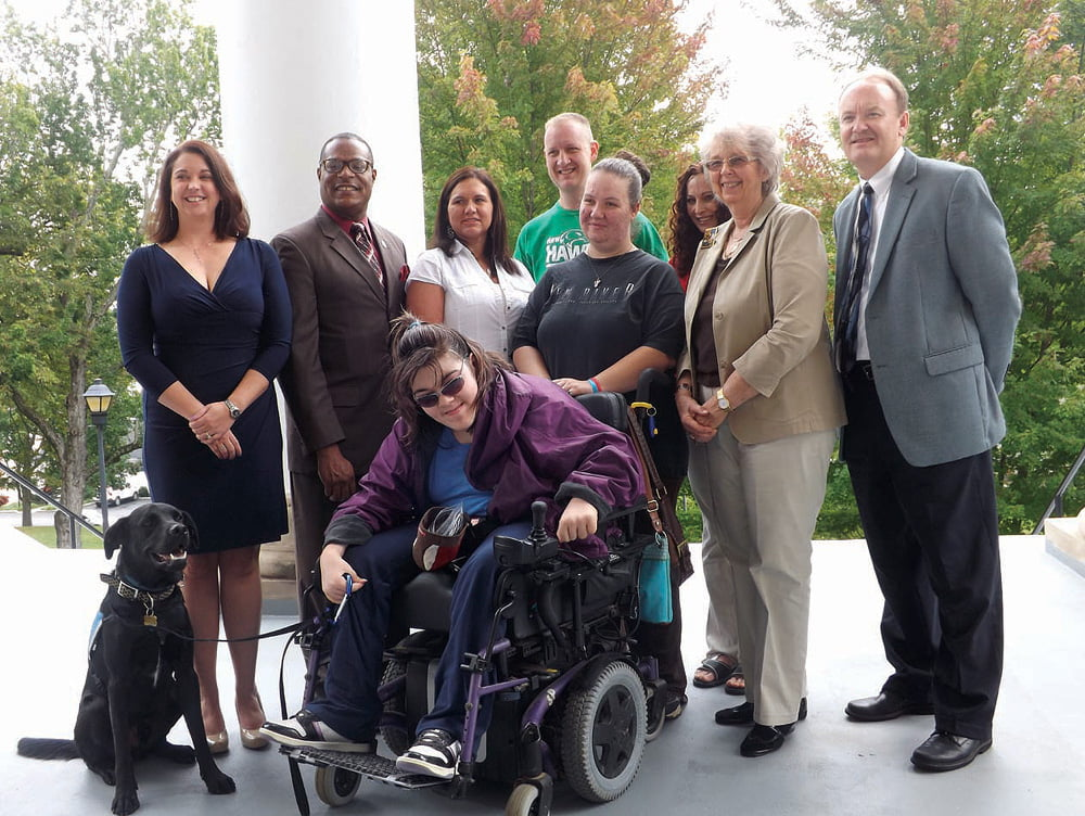 Front: Bethany McFerrin with service dog Koby; Back: Donna Polk, student program advisor at the Greenbrier Valley Campus and co-sponsor of PTK (left); NRCTC president Dr. L. Marshall Washington; Joanna Post, PTK past president; Terry Holliday, current president of Phi Theta Kappa; Raylene Green and Jennifer Bowman, PTK representatives; NRCTC faculty co-sponsor Lucie Refsland and Dr. Alan Withers, student services