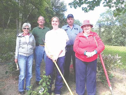 """Rainelle Mayor Andrea Pendleton, Don Ratliff, Governor's Representative Kimberly Gross, Mike Stout, and Roxie Hume working to landscape Rainelle Cemetery as one of the Town's four Governor Earl Ray Tomblin's """"Day to Serve"""" projects."""