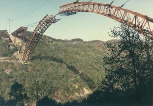During the 1970's construction crews braved high winds and frigid temperatures to build the New River Gorge Bridge. (Photo Courtesy of West Virginia State Archives)