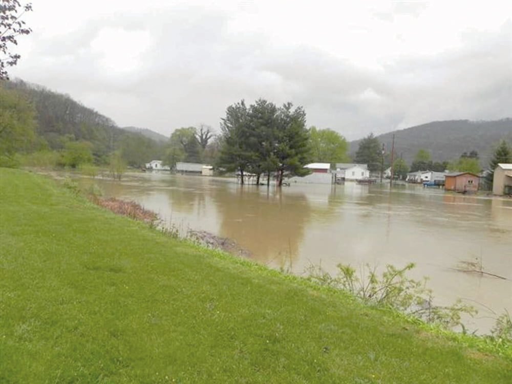 Pictures of the 2012 flood typical of flooding that recurs all too frequently along Sewell Creek, Boggs Creek and Meadow River in Rainelle