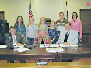 In recognition of National 4-H Week, Robin Haynes (left) and Emily Cross (far right) with Hallee and Sallee Richmond, Suzanne Bicksler and Walker Hager, participating 4-H students whose positive experiences within the various programs were cited at the GCC meeting.