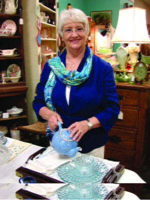 Local antique dealer Karen McClung assists the Friends of the Library in preparation of centerpieces for the 32nd Annual Salad Luncheon scheduled for Nov. 7 from 11 a.m. to 1 p.m.