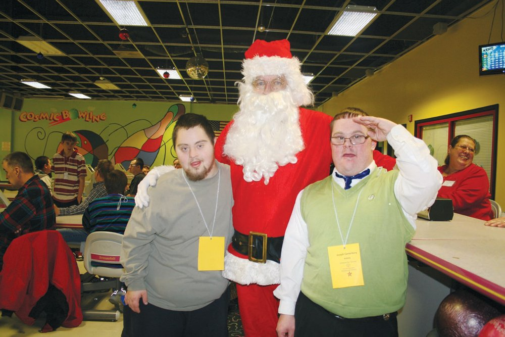 Greenbrier County Special Olympics athletes Josh Miller and Joseph Canterbury share a smile with Santa Claus at the Greenbrier Bowling Alley after last year's Cannon Ball Bowling Tournament.