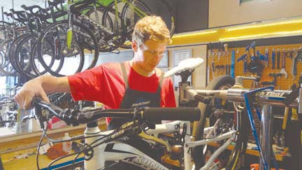 Hill and Holler Bicycle Works service manager Stu Schwab on the job