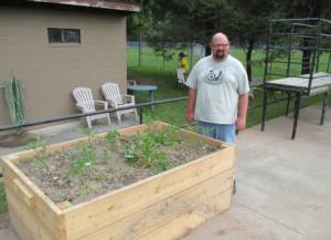 Joshua Thomas, of Greenworks Recycling, has leased a plot and filled it with peppers, squash, cucumbers, strawberries and tomatoes.