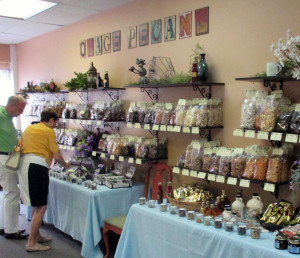 Customers sample a variety of gourmet nuts available at Osage: The Pecan Company of Lewisburg, located at 204 West Washington Street