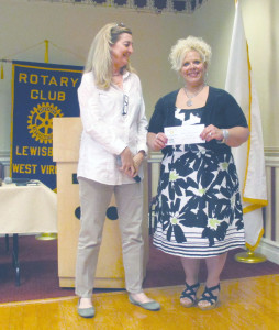 Lewisburg Rotary's Martha Hilton presents Children's Home Society's Amanda Thomas with an $800 check. The donation money was raised in February with the sale of Valentines Day cakes made by Hilton and a few volunteers from Rotary.