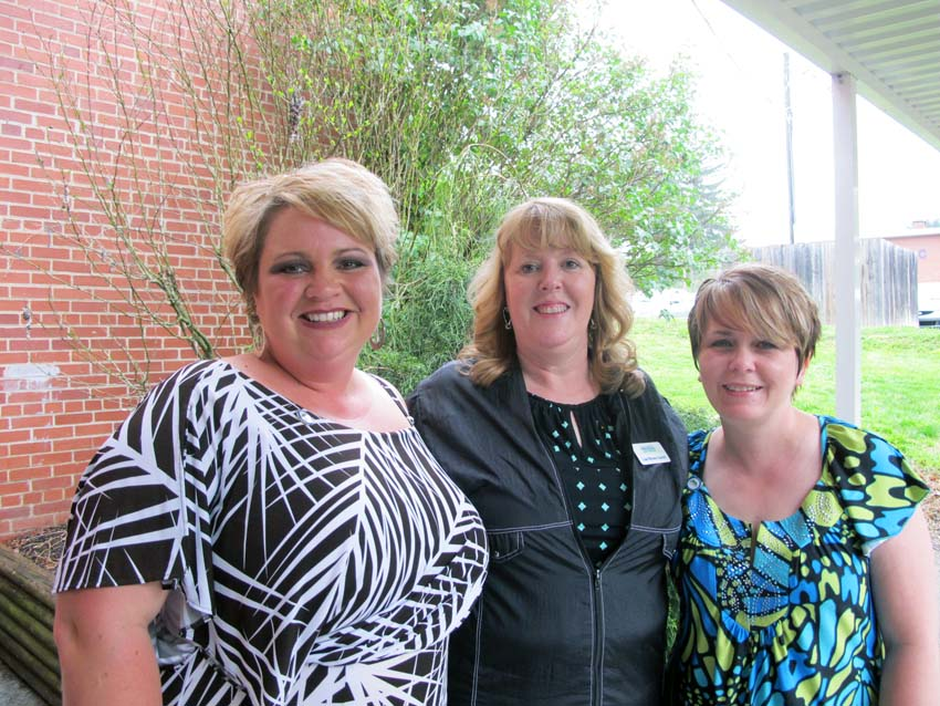 Crystal Yates (left) and Stephanie Baldwin (right) pictured with New River Community and Technical College Cosmetology Program Director Lisa Carter