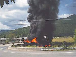 A tanker truck carrying 7,800 gallons of diesel overturned and burned on the bridge at the intersection of Rt. 250/92/28 at Bartow in Pocahontas County Tuesday afternoon (Photo courtesy of Jonah Bauserman)