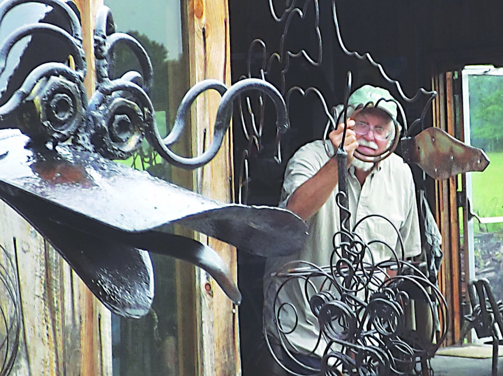 Mark Blumenstein and some of his unconventional metal art pieces