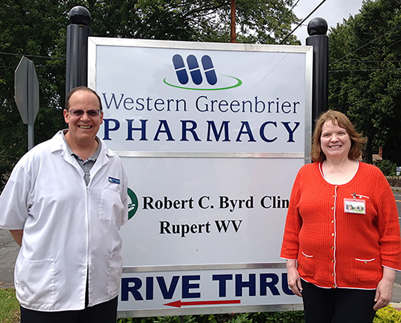 Bob Weed, R.Ph., managing pharmacist at Western Greenbrier Pharmacy (left) and Family Nurse Practitioner, Pamela Edens, DNP, with Robert C. Byrd Clinic's new primary care office in Rupert, work together to plan the upcoming Open House event.