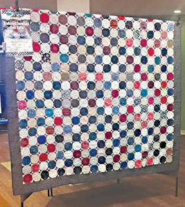 The one-of-a-kind handmade heirloom Snowflake quilt made and donated by living legend Frances Smith. The money raised from the sale of the raffle tickets (sold at the Lewisburg Farmers Market beside the Lewisburg Post Office on Saturdays for the next few Saturdays) will go to funds necessary to the nonprofit Lewisburg Farmers Market.