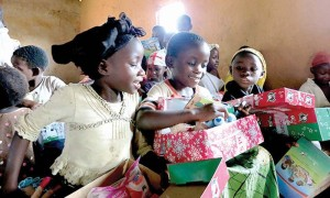 Children receiving their gift via Operation Christmas Child. For complete details on how to pack, label and ship or deliver gift shoeboxes, visit Samaritan's Purse's website and click on the Operation Christmas Child link.