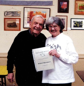Robert Mareneck is presented with Greenbrier Artists lifetime membership certificate by Jeanne Brenneman