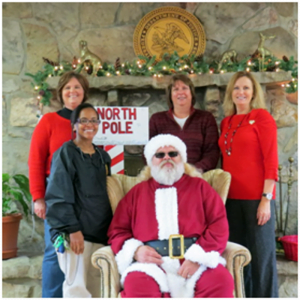 Front Row: Phyllis Sea (left) and Santa (Don Fraley); 2nd Row: Joy Bowling, Warden Barbara Rickard and Tina Wickline helped make Christmas special for some area boys and girls during the FPC Alderson Annual Community Christmas Party.