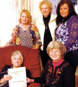 Olive Jo McCoy is presented with Greenbrier Artists lifetime membership certificate by Jeanne Brenneman. Standing: Sue Porter (left), Phyllis Crickenberger and Shelby Oreolt