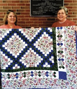 Deb Matheny (left), winner of the Quilt of Hope with Brinda Renick who presented the quilt