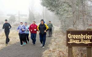 With friends and family, Dan Withrow, fifth from the left, embarking on his 31st anniversary of daily running. He began this day's run on the Greenbrier River Trail from its Caldwell entrance.