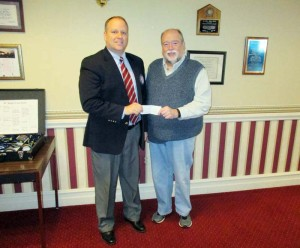 First National Bank President Matt Burns (left) presents Ronceverte Mayor David Smith with a $500 donation to the City of Ronceverte's Comprehensive Plan. Having already donated $100 earlier, the additional donation on Jan. 5 brings First National Bank's total support of the plan to $600.
