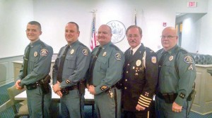 Patrolman Nicholas Sams, Lt. Jeromy Dove (both at right), and Cpl. Mike Arbaugh (far left) were honored at a ceremony at the Tuesday night Lewisburg city council meeting. All three received commendations and the silver star for bravery. They are pictured with Chief Tim Stover (center) and WV National Association of Chiefs Chaplain Jack Rinchinch. (Photo by Shannon Beatty, Lewisburg City Recorder)