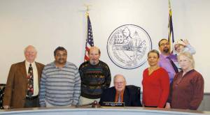 Mayor John Manchester signs Lewisburg's Martin Luther King, Jr. Week proclamation. Flanking the seated Mayor are: Larry Davis (left), Clifford Curry, Steve Rutledge, Wanda Johnson, Danny Seams, Daniel Patrick Seams and Ellen Broudy.