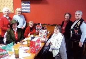 Williamsburg CEOS 2014 Christmas Party - Seated: Cassandria Perkins (left), Loretta Shirley and Ruth Kreft; Standing: Blanche Knicely (left), Patty Post, Virginia Hanna and Barbara Deeds.