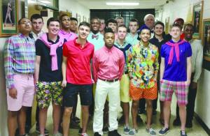 All of the young men of the Greenbrier East High School basketball team at the ready to hit the runway, posing in grand duds with their coach and event sponsor Jim Justice.