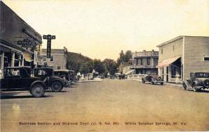 A postcard (approximate date: latter 1920s) showing downtown White Sulphur Springs when the Midland Trail went through features the Greenbrier Pharmacy building (at right) as well as Main Street in the center of town. (Courtesy of C. Michael Williams)
