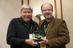 Rodney Fink (left) was presented the Distinguished Alumni of the Year Award by Mark Waddell at WVSOM's annual Mid-Winter Osteopathic Seminar in Charleston.