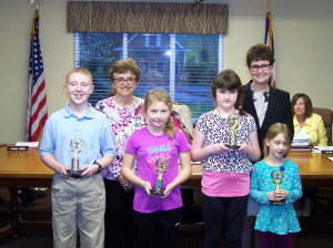 Front Row: Logan Toothman, Lewisburg Baptist Academy (left); Willa Gibson, Frankford Elementary; Abby Flowler, Ronceverte Elementary and Davia Zimmerman, Lewisburg Elementary; Back Row: Young Writers Contest Coordinator Jo Long (left) and Superintendent Sallie Dalton. (Not pictured: Bryce Holley and Kendra Webb)