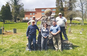 The Lewisburg in Bloom Committee would like to thank The Greenbrier Hotel's Grounds and Engineering Departments for cutting down and grinding the huge old stump in the Dick Pointer Cemetery and for helping to kill the ivy in the trees as a community service project. Pictured: John Lewis (left), Joe Mundy, Ben Erickson, Shannon Beatty and Curtis Webb.