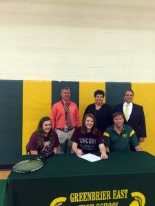 Greenbrier East High School senior Amy Ahern (center) signs a letter of intent to attend Concord University and play tennis next fall. She is joined by sister Anna Ahern (left), GEHS Athletic Director Ben Routson, mother Renee Ahern, father and GEHS tennis coach Norman Ahern and Principal Jeff Bryant. Photo and text by Sarah Mansheim