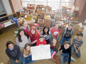EGMS 8th Grade Student Government students helped with food collection and organization. Front Row: Rhiannon Cohernour (left), Skyler McCallister, Brett Napier, Savannah Soucier and Gracie Cornelius; Back Row: Natalie Harper (left), Taylor Keeling, Emily Swann, Kara Vaughan, Edwin Coffman and Joey Daniels.