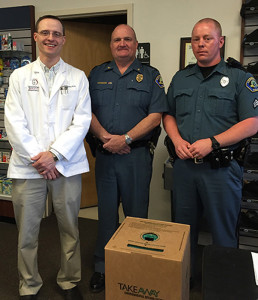 Aaron Gwinn, pharmacist at Greenbrier Medical Arts Pharmacy (left), with Chief T.L. Stover and Sgt. D.B. Eggleston, K-9 handler, with the Lewisburg Police Department. Sgt. Eggleston was responsible for the collection of narcotics at the Earth Day event.