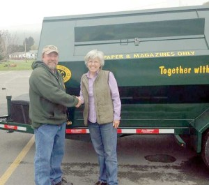 Greenbrier Recycling Center's Bob Bennett delivers a new recycling bin to Rainelle's Mayor Andrea Pendleton. The new bin will provide newspaper and magazine recycling availability for Rainelle. The money for the new bin was awarded by a Solid Waste Management Grant. The bin is located at City Hall. It is very important for the success of this recycling project that citizens put only newspaper in the newspaper slot and only magazines in the magazine slot.