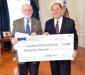 Governor Earl Ray Tomblin (right) presents symbolic check to Skip Deegans, member of the Friends of the Blue Committee