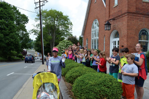 Cyndi Graves stops at the Lewisburg United Methodist Church to field questions from curious preschoolers about running across the United States. Graves passed through Lewisburg on Tuesday afternoon to much fanfare from local merchants and the Greenbrier Valley Convention and Visitors Bureau.