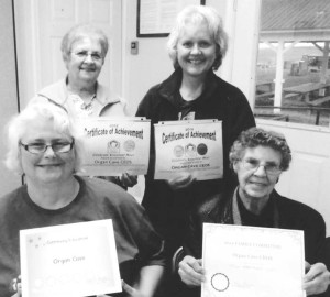 Organ Cave CEOS display certificates received at Greenbrier County Achievement Program. Seated: Sandy Perry (left) and Layola Sarver; Back: Janet Johnson (left) and Carolyn Rodgers