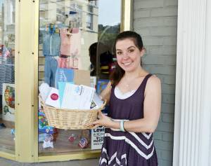 Siobhan Winters holds a raffle basket filled with gift certificates and merchandise from local businesses. The raffle will benefit the Lewisburg-Fairlea food locker.