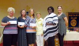 At Monday's Lewisburg Rotary Club meeting, several area non-profits were awarded financial donation from the club. Rotarians Martha Hilton and Sue Rosshirt delivered the following donations: Joan Reed accepted $500 for the Shepherd Center; Kasey Carter accepted $750 for Community in Schools; Amanda Thomas accepted $612 from the Rotary Has Heart Fundraiser for the Children's Home Society; Kenosha Davenport accepted $750 for the Family Refuge Center. (Not pictured, but also receiving a $1,000 donation was the Greenbrier County Committee on Aging.)