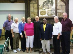 "Newly elected council members Ted Humphreys (left), Larry Wakeford and Mark Gillespie, with reelected Recorder Peggy Bland, Judge James J. Rowe, re-elected Mayor Lloyd Haynes, and reelected council members Audrey Van Buren and George ""GP"" Parker. (Photo by Linda Coleman)"