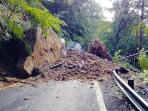 Around 5,000 tons of rock and debris caused by heavy rain closed WV Rt. 82 in Nicholas County near Craigsville and Muddlety on Monday. Additional storms on Tuesday hindered cleanup efforts and crews were forced to stop work due to safety concerns. The road is scheduled to be cleared by Friday, July 17. Motorists are asked to use caution. (Photo courtesy of WVDOT)