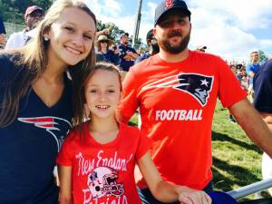 """Bailee and Lilly Jackson and David Wilson - Union, WV David Wilson, Bailee and Lilly Jackson were excited to see their favorite team so close to home.   """"We are so excited,"""" Bailee Jackson said. """"We can see our team and do not have to travel to New England to do it."""" David Wilson added that he feels this event is an asset to the entire region.  """"It gives this area and the surrounding towns a good name."""" (Photo by Leah Deitz)"""