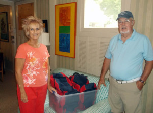 Carol Bailey (left) presented Perk Berry with the back-packs which were fully supplied for a successful start to the new school year which began Aug. 6 in Greenbrier County.