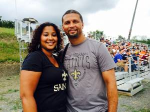 """Priscilla Perez and Derek Smith - Washington, DC Perez and Smith traveled from the DC area to see the Saints. But Smith said now that he has seen the area he wants to come back. """"I wouldn't mind to stay a few nights at the resort,"""" he said. """"It looks like there is a lot to do.""""  (Photo by Leah Deitz)"""