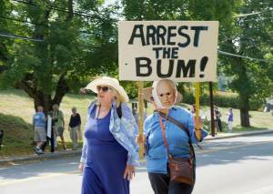 Protesters at The Greenbrier march against the state chamber of commerce's inclusion of former Vice President Dick Cheney as a keynote speaker.