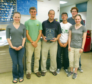Sarah Leslie (left), Ben Robinson, Instructor of the Year Kevin Warfield, Ethan Meadows, Conner Morgan and Erin Leslie sporting Spartan pride in the engineering lab.