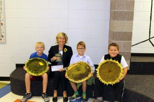 John Wade, 2nd grader/3rd place winner with 53 inches (right); 5th grader Lawson Hamiliton, 1st Place winner measuring at 57 inches; Mrs. Townley Hamiliton with the Lewisburg Garden Club, and 4th grader Gavin Pyne, our 3rd place winner at 52 inches (left)