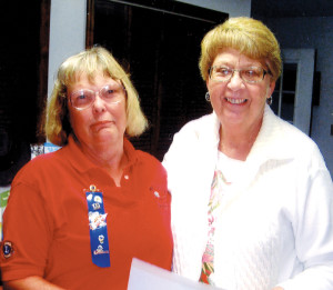 President Connie McMichael (left) presented a 25 year pin to Lion Betty Gillespie for many years of dedicated service